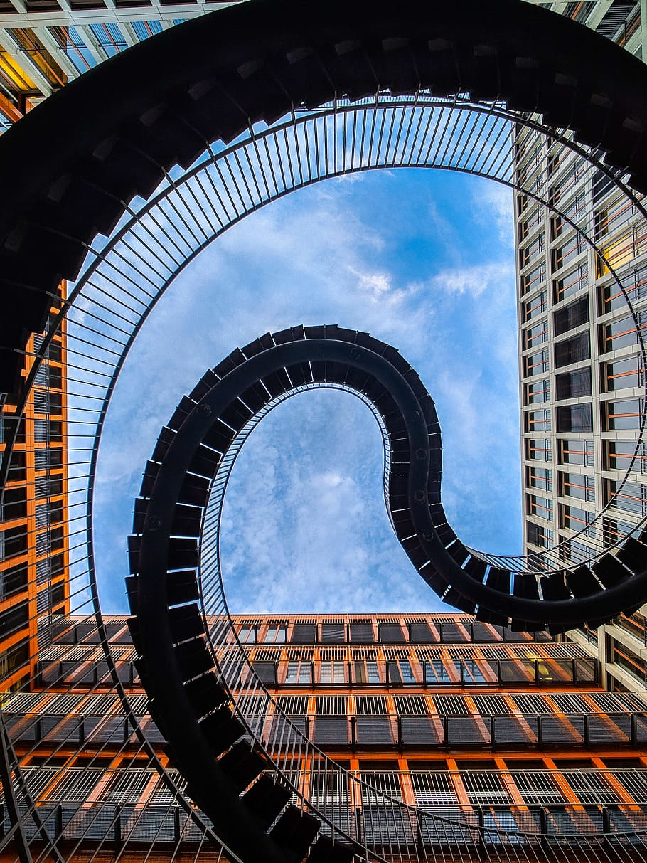 worms eye view photography spiral stairs