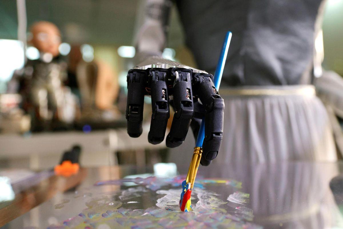 sophia robot painting self portrait